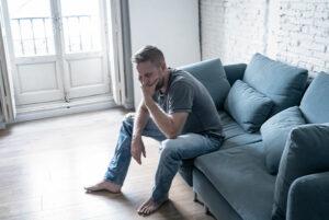Aloof man sitting on sofa