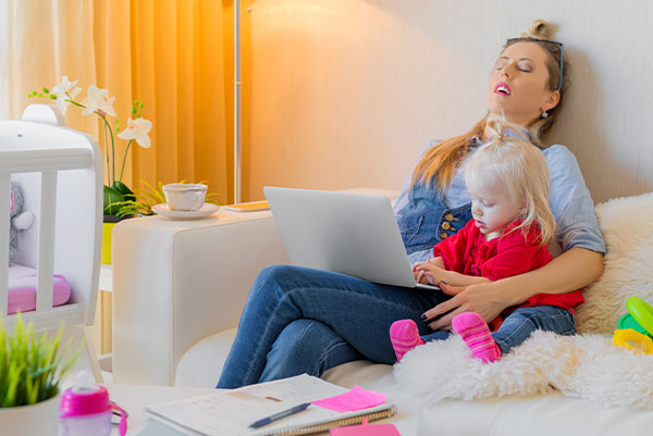 exhausted working mom with toddler